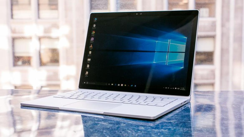 laptop screen displaying microsoft office wallpaper
